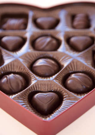 a close-up shot of valentine's day chocolates with the focus on the foreground of a heart shaped chocolate 写真素材