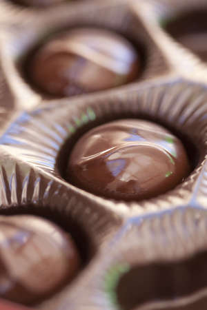 a small set of milk chocolate pieces with a close-up view of the chocolates