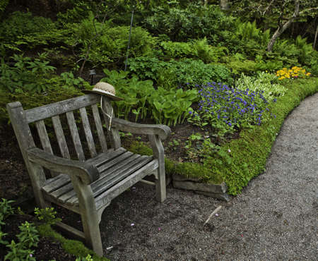 metis: Small bench in Jardins de Metis, Gaspesie, Quebec  Stock Photo