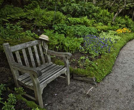 metis: Small bench in Jardins de Metis, Gaspesie, Quebec  Stock Photo