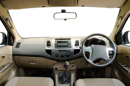 car dashboard: beige car dashboard with isolated windshield, windows and and mirrors Stock Photo