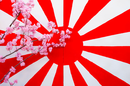 synthesis: Japan flag on the old wooden background with synthesis sakura flower Stock Photo