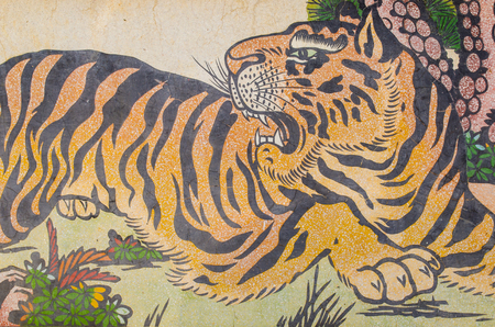 shrine: tiger painting on granite wall in Chinese shrine