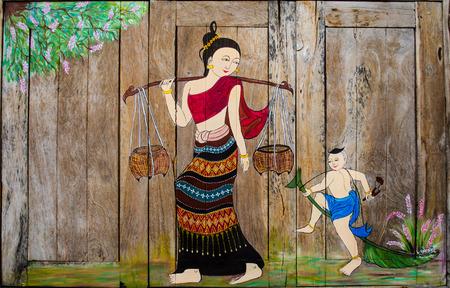 les femmes thai et la peinture de l'enfant à la fenêtre de marché à Nan, Thaïlande Banque d'images