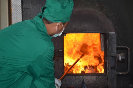 incinerator: man working with Incinerator Stock Photo