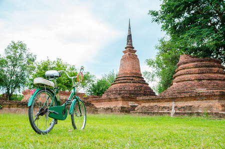 green bicycle with ancient temple, focus on bicycle