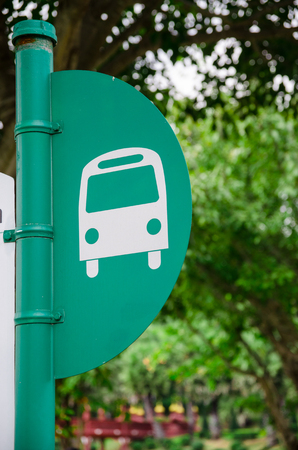 bus stop pole in green tree background Stock Photo