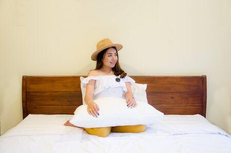 asian girl on white bed