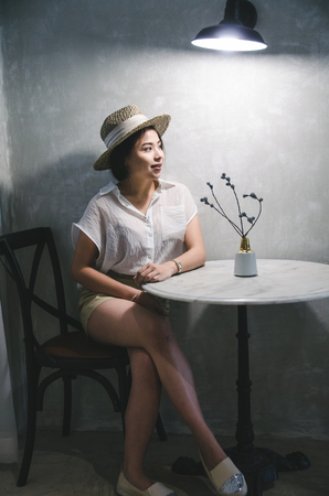 women sitting in living room with dark light