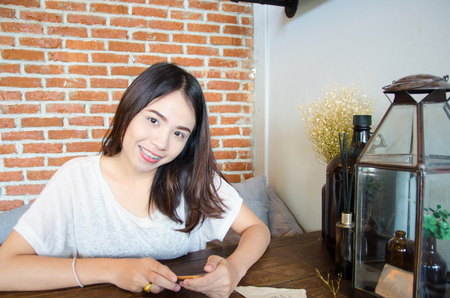 asian girl smile face in cafe coffee Imagens - 122879984