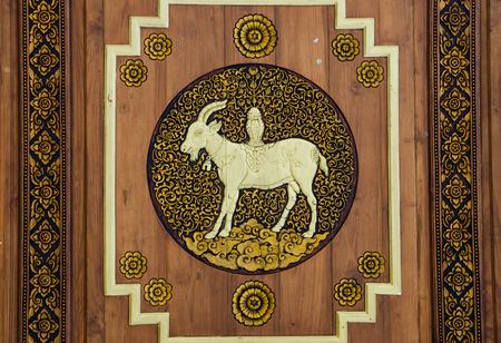 wooden goat zodiac symbol carve