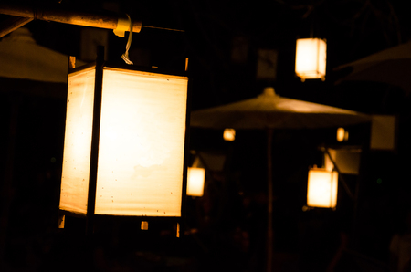 thai ancient lamp hanging on wood