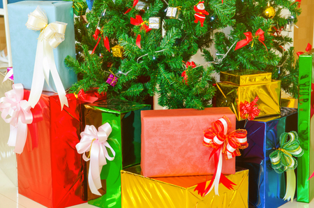colorful gift under christmas tree Imagens