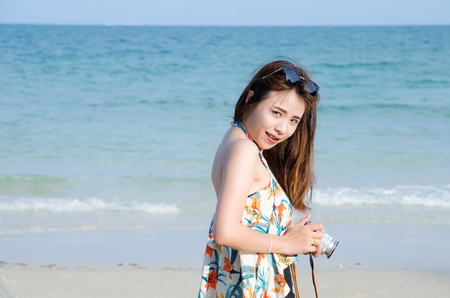 asian women portrait with smile face on beach