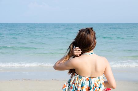 asian women portrait touch her hair on beach
