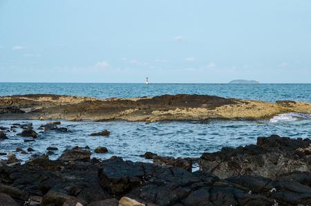 black stone with blue sea Imagens