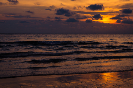 sea and sand with sunset Imagens