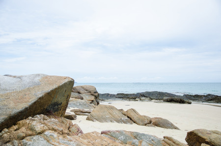 great stone on beach with sea background