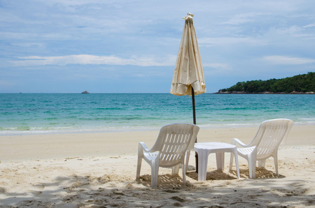 white chair with umbrella Imagens
