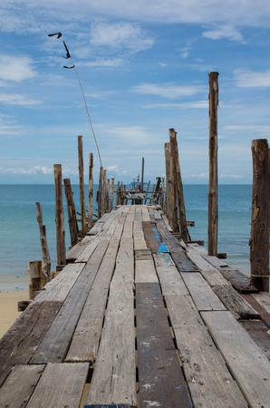 old bridge on beach and sea
