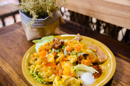 thai style noodle on wooden table and dry flower