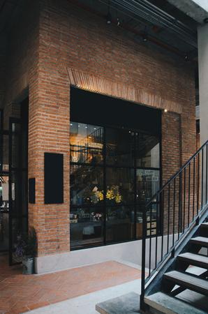 Corner of brick building with mirror