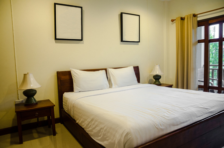 interior of bedroom with white bed