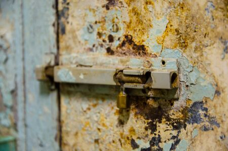 old latch is locking pale door