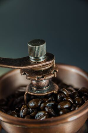 close up of coffee beans in coffee grinder in vertical view Stock Photo