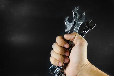 hand hold wrench on blackground