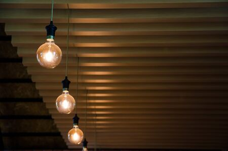 round light lamp hanging on wooden ceiling