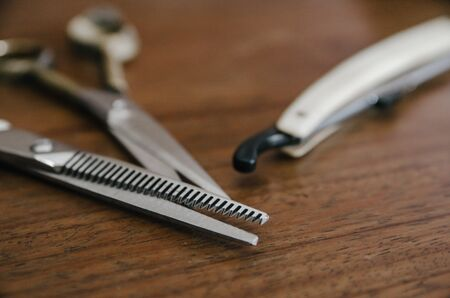 close up of barber tool on wooden table Stock Photo