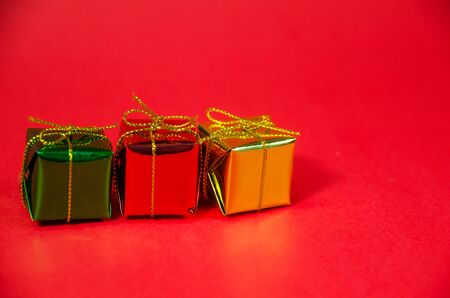 row of gift box on red background