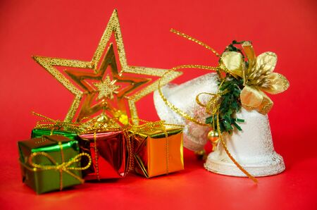 group of bell, gift and star in christmas on red background