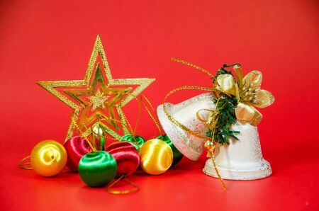 group of bell, ball and gift in christmas on red background