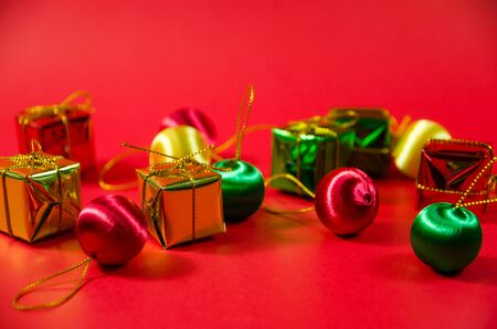 group of  ball and gift in christmas on red background on top view