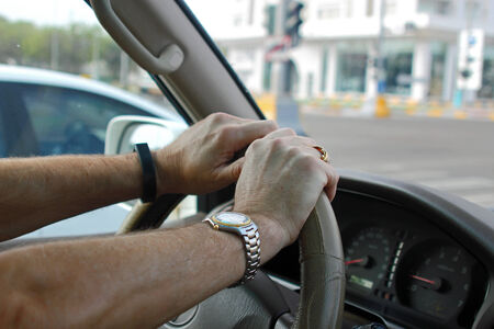 road safety: Hands on a car steering wheel depicting road safety  Stock Photo