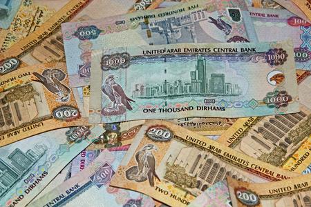 arabic currency: Pile of UAE money denoting wealth Stock Photo