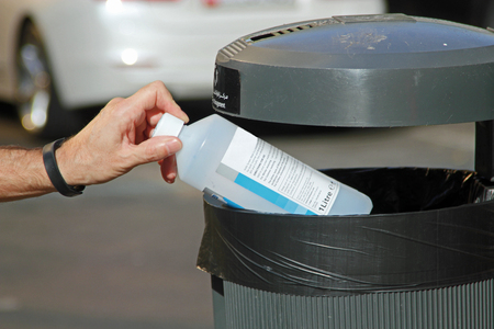 responsibly: Responsibly putting rubbish in the bin for recycling