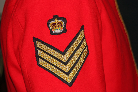 Uniformed arm of a UK Military Staff Sergeant photo