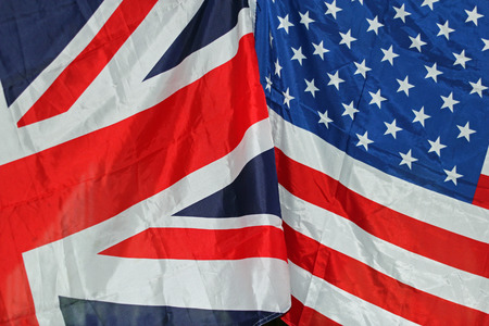 UK and US flags together symbolizing coalition, peace and joint forces photo