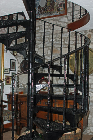 Black metal ornate spiral staircase in an old country cottage