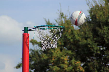 Shot of a net ball going into the net symbolizing exercise, team sports and competition Фото со стока
