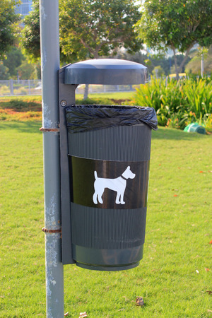 Bin in a park specifically designated for dog mess photo
