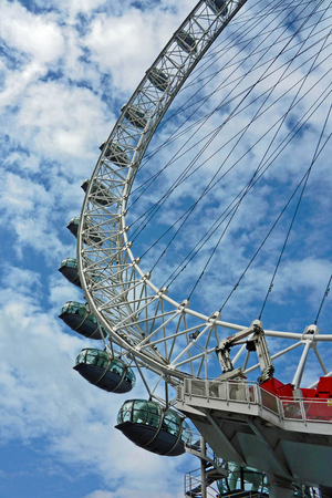 millennium wheel: View of the pods of the London EyeMillennium Wheel in London against the blue sky with fluffy white clouds Stock Photo