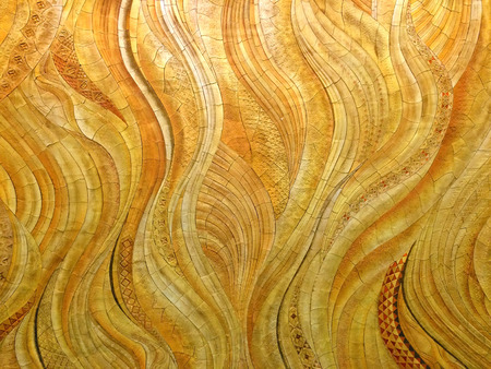 Background swirls of marble in golds, yellows and reds