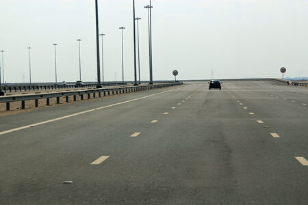 Five lane highway with very few cars symbolizing new roads, lack of traffic and safety