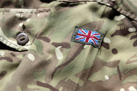 Close up of UK military uniform with a union flag on the arm Foto de archivo