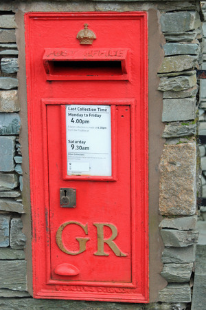 red post box: British red post box with letters GR designating a post box from the time of King George VI