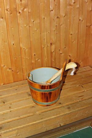 relaxion: Sauna bucket in a sauna symbolizing relaxation, health and spa treatments